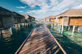 Jetty leading to water villas. Maldives - PhotoDune Item for Sale