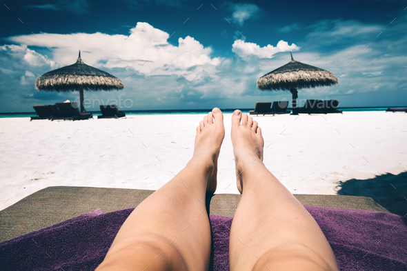 Resting on a beach. First person view. Maldives - Stock Photo - Images
