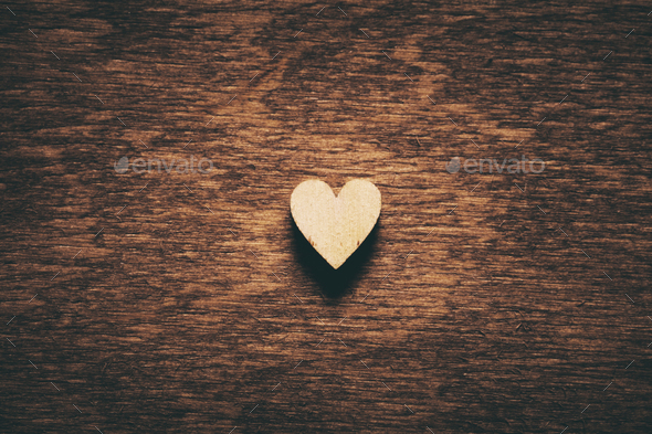 Heart on dark wooden background - Stock Photo - Images
