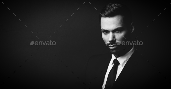 Black and white portrait of young businessman - Stock Photo - Images