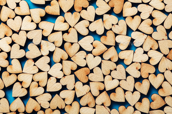 Wooden hearts on blue background. - Stock Photo - Images