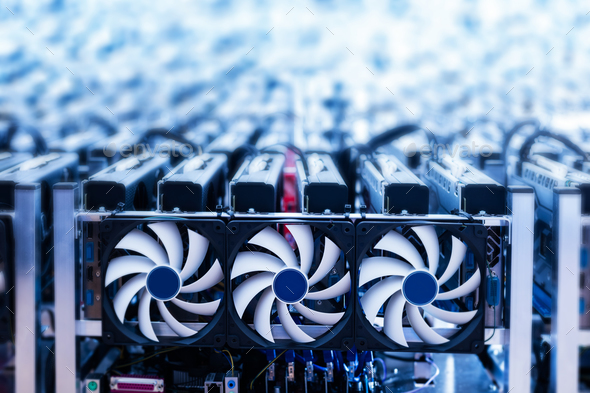 Bitcoin miner. IT device with cooling fans. - Stock Photo - Images
