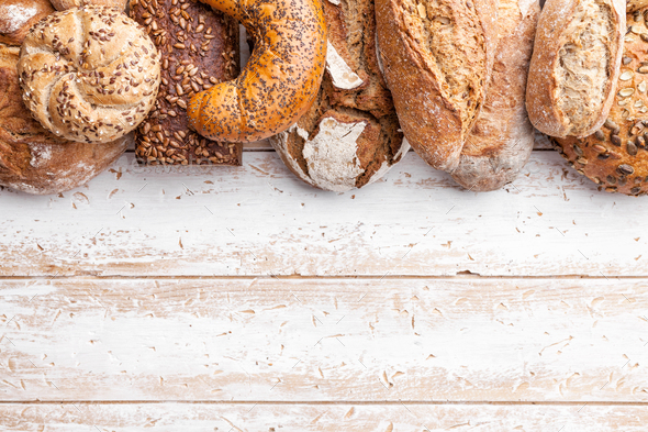 Delicious fresh bread on wooden background - Stock Photo - Images