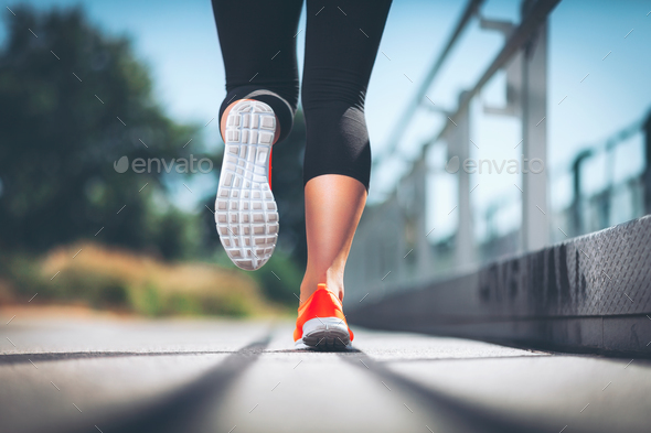 City workout. Woman running in an urban setting - Stock Photo - Images