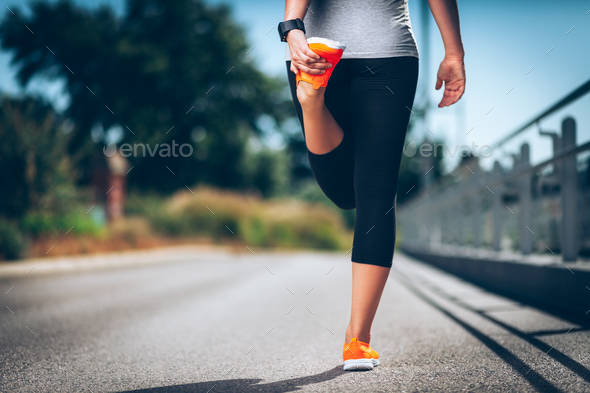 City workout. Beautiful woman with a smartwatch training in an urban setting - Stock Photo - Images