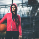 Female basketball player training outdoors on a local court - PhotoDune Item for Sale