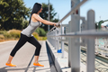 City workout. Beautiful woman training in an urban setting - PhotoDune Item for Sale