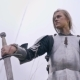 Jeanne D'Arc Takes the Sword and Watches As She Squeezes It in Her Hand - VideoHive Item for Sale