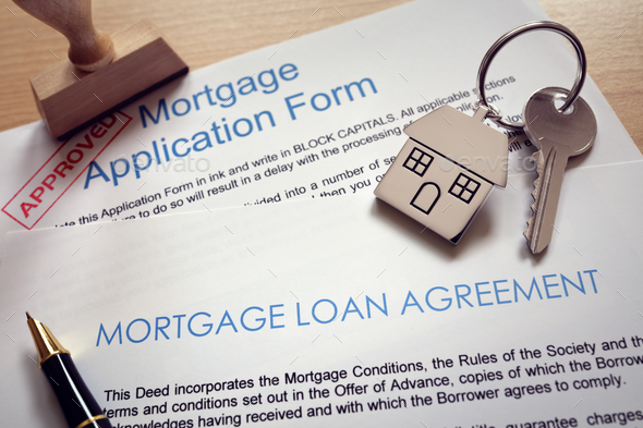 Mortgage application loan agreement and house key - Stock Photo - Images