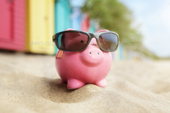 Piggy bank on beach vacation - Stock Photo - Images
