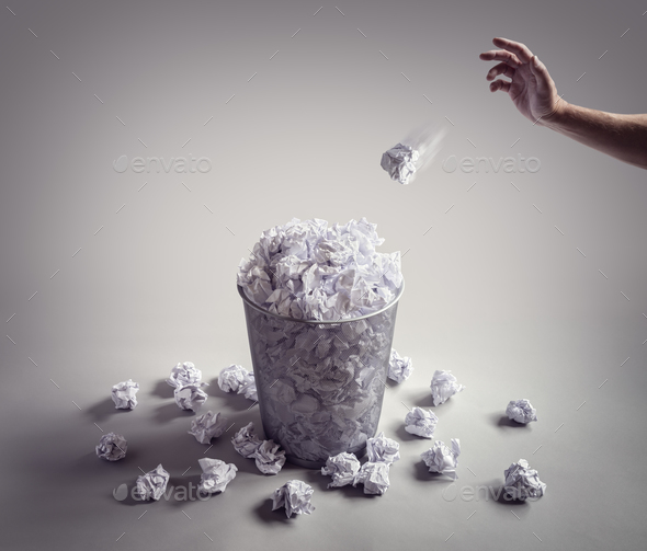 Throw it in the waste paper basket or office bin - Stock Photo - Images