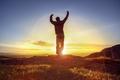 Happy man celebrating winning success against sunset - PhotoDune Item for Sale