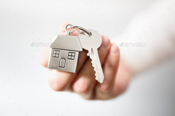 Real estate agent giving house keys - Stock Photo - Images