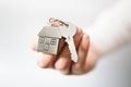 Real estate agent giving house keys - PhotoDune Item for Sale