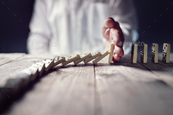 Stop the domino effect concept for business solution and interve - Stock Photo - Images