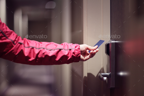 Opening hotel door with keyless entry card - Stock Photo - Images