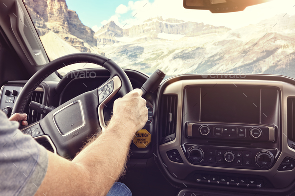 Driving a car or truck on a rural road through the mountains - Stock Photo - Images
