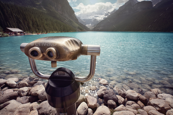 Looking at view across Lake Louise through binoculars - Stock Photo - Images