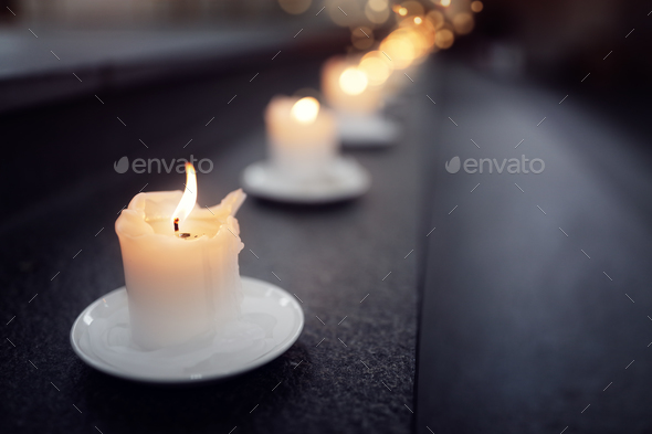 Candles on alter steps in a church - Stock Photo - Images