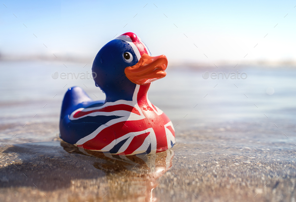 British flag rubber duck in the sea - Stock Photo - Images