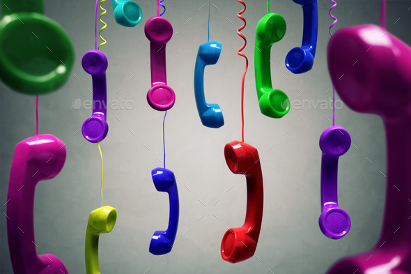 Red and multi-coloured telephone receiver hanging - Stock Photo - Images