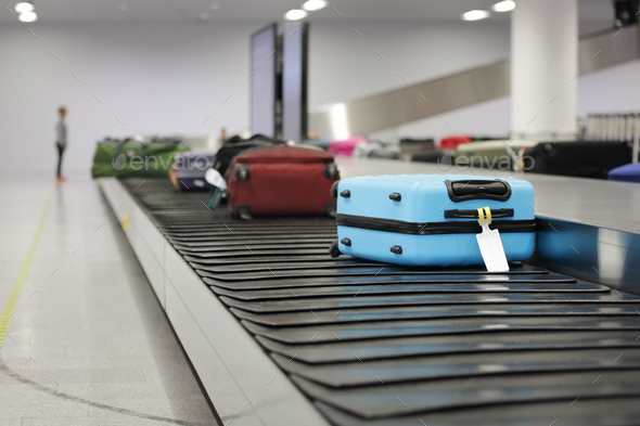 Suitcase or luggage on conveyor belt in the airport - Stock Photo - Images