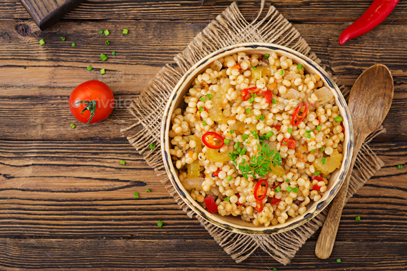 Vegetarian porridge from Turkish couscous with vegetables. Dietary menu. Vegan cuisine. Top view - Stock Photo - Images