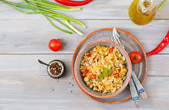 Porridge from Turkish couscous with beef and vegetables. Dietary menu. Top view. - Stock Photo - Images
