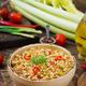 Vegetarian porridge from Turkish couscous with vegetables. Dietary menu. Vegan cuisine. - PhotoDune Item for Sale