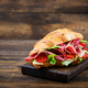 Tasty breakfast. Appetizing croissant with salami and, cheese and tomatoes - PhotoDune Item for Sale
