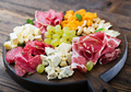 Antipasto catering platter with bacon, jerky, sausage, blue cheese and grapes  - PhotoDune Item for Sale