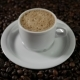A White Cup of Evaporating Coffee Foam on a Table with Fried Beans - VideoHive Item for Sale