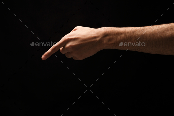 Hand gestures - man pointing, isolated at black - Stock Photo - Images