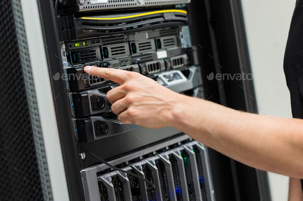 Close-up of IT Engineer Switching On Server At Datacenter - Stock Photo - Images