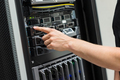 Close-up of IT Engineer Switching On Server At Datacenter - PhotoDune Item for Sale