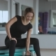 Woman Exercise with Dumbbell at Fitness Gym - VideoHive Item for Sale