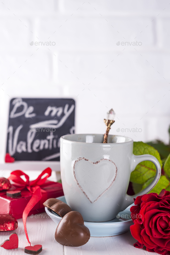 Red rose, coffee cup and gift box - Stock Photo - Images