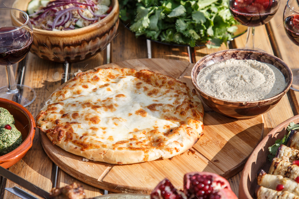 Traditional Georgian bread with cheese - khachapuri - Stock Photo - Images