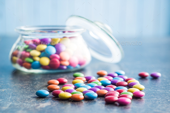 Colorful chocolate candies in jar. - Stock Photo - Images