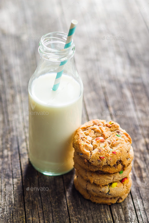 Sweet cookies with colorful candies and milk. - Stock Photo - Images