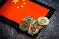 Golden bitcoins and chinese flag. - PhotoDune Item for Sale