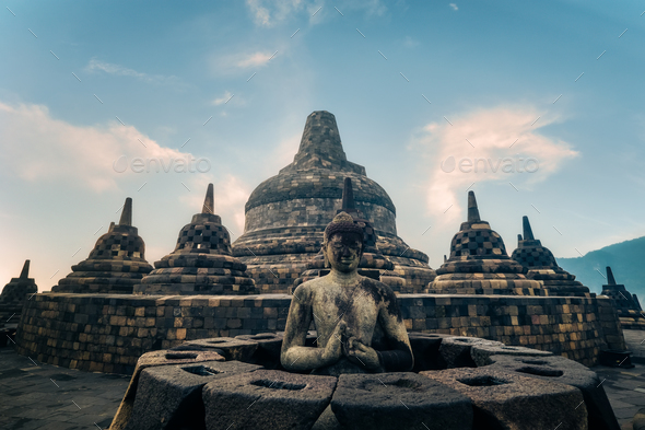 Statue of meditating Buddha. Borobudur temple. Java, Indonesia - Stock Photo - Images