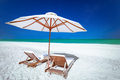 Amazing tropical beach with chairs and umbrella on sand - PhotoDune Item for Sale