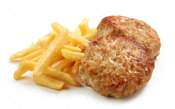 fried potatoes and chicken cutlets - Stock Photo - Images
