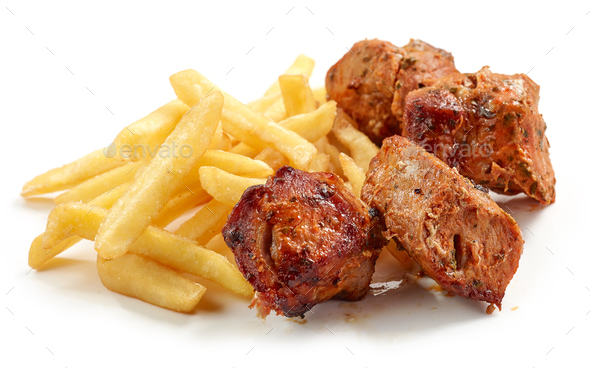 fried potatoes and pork kebab - Stock Photo - Images
