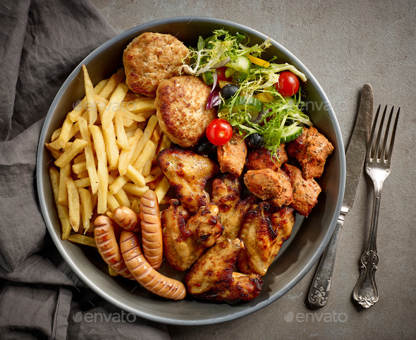 plate of various meat and vegetables - Stock Photo - Images
