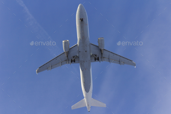Airplane flies against a background of white cloud - Stock Photo - Images
