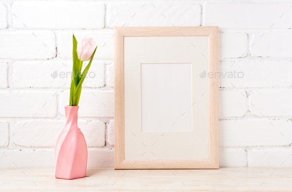 Wooden frame mockup with pink tulip in swirled vase - Stock Photo - Images
