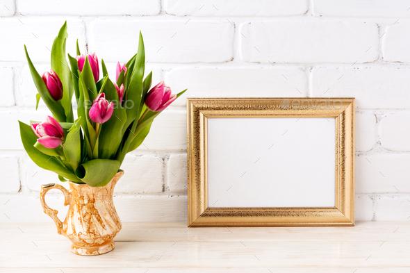 Golden  landscape frame mockup with pink tulips in jug - Stock Photo - Images