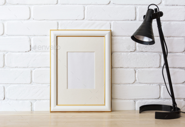 Gold decorated frame mockup with black lamp - Stock Photo - Images